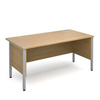 Maestro 25 SL straight desk with side modesty panels 1600mm x 800mm - silver H-Frame, oak top